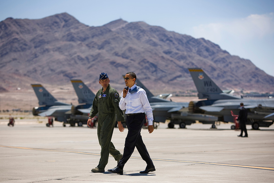 U.S. President Barack Obama walks past F-16 aircraft with Brigadier General Stanley Ted Kresge at Nellis Air Force Base in Las Vegas, Nevada. ..Photo by Brooks Kraft/Corbis.......