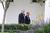 Director of the National Economic Council and Chief Economic Advisor to the President, Gary Cohn, left, walks with a staff member from the Oval Office to the residence at the White House as he prepares to board Marine One with the President of the United States Donald J. Trump on October 11th, 2017 in Washington, D.C. <br /> Credit: Alex Edelman / CNP