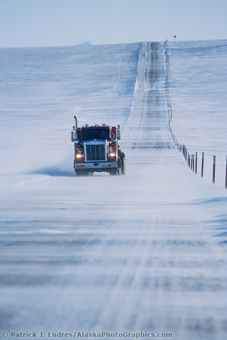 High winds blow drifting snow across the James Dalton Highway north of the Brooks Mountain Range, on Alaska's Arctic Coastal Plains.