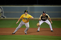 Siena Saints Matt Livingston (44) leads off in front of first baseman Connor Allen (39) during a game against the UCF Knights on February 14, 2020 at John Euliano Park in Orlando, Florida.  UCF defeated Siena 2-1.  (Mike Janes/Four Seam Images)