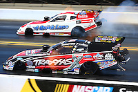 Jul. 27, 2014; Sonoma, CA, USA; NHRA funny car driver Courtney Force (near) races alongside Bob Tasca III during the Sonoma Nationals at Sonoma Raceway. Mandatory Credit: Mark J. Rebilas-