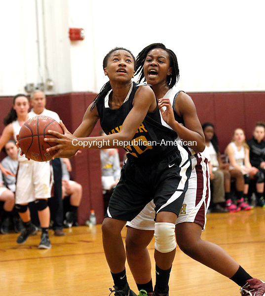 Waterbury, CT- 02 January 2016-010216CM02-  Kaynor Tech's Egypt Santos looks for the basket as Sacred Heart's Mahnue Sahn defends during the Sacred Heart Holiday Tournament in Waterbury on Saturday.      Christopher Massa Republican-American