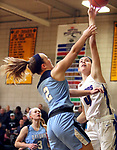 WATERBURY CT. 16 February 2018-021619SV06-#4 Olivia Heslin of St. Paul puts up a basket over #2 Kelly Shpak of Oxford during the NVL girls basketball tournament in Waterbury Saturday.<br /> Steven Valenti Republican-American