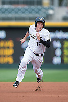 Jason Coats (17) of the Charlotte Knights hustles towards third base against the Syracuse Chiefs at BB&T BallPark on June 1, 2016 in Charlotte, North Carolina.  The Knights defeated the Chiefs 5-3.  (Brian Westerholt/Four Seam Images)