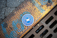 Warning sign on a storm drain in Hoboken, NJ seen on Saturday, July 21, 2012 relating to wastewater bypassing treatment and going directly into the waterway. Heavy rains inundate sewage treatment plants and runoff still goes into the rivers. (© Richard B. Levine)