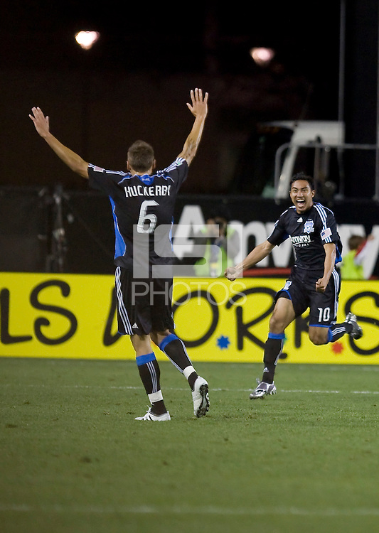Arturo Alvarez (10) runs to celebrate his goal with Darren Huckerby (6). San Jose Earthquakes defeated Houston Dynamo 3-2 at Buck Shaw Stadium in Santa Clara, California on March 28th, 2009.