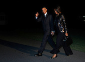 United States President Barack Obama waves to the photographers as he and first lady Michelle Obama arrive at the White House in Washington, DC on April 11, 2014 following a trip to New York.  <br /> Credit: Dennis Brack / Pool via CNP