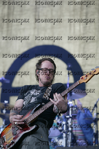 Weezer - bass player Scott Shriner performing live on Day Two on the Main Stage at the Leeds Festival 2010 at Bramham Park Leeds UK - 28 Aug 2010.  Photo credit: Tony Woolliscroft/IconicPix