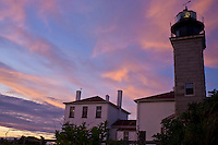 An artistic sky during sunset at Beavertail Lighthouse