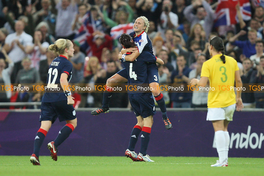Jill Scott embraces GB goalscorer Steph Houghton at the final whistle - Great Britain Women vs Brazil Women - Womens Olympic Football Tournament London 2012 Group E at Wembley Stadium, London - 31/07/12 - MANDATORY CREDIT: Gavin Ellis/SHEKICKS/TGSPHOTO - Self billing applies where appropriate - 0845 094 6026 - contact@tgsphoto.co.uk - NO UNPAID USE.