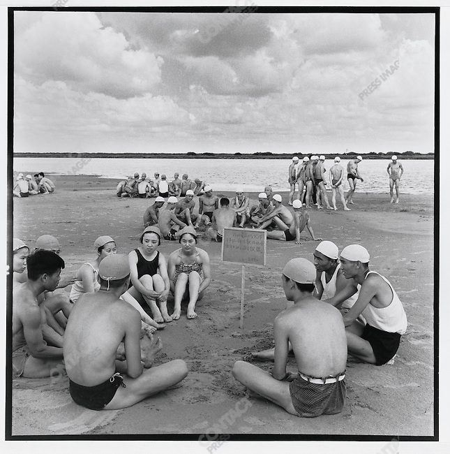 "Swimmers read ""Mao Zedong's thoughts"" as they prepare to plunge into the Songhua River to commemorate the second anniversary of Mao's swim in the Yangtze; Harbin, Heilongjiang Province, July 16, 1968"