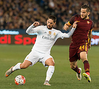 Melbourne, 18 July 2015 - Isco of Real Madrid and Kostas Manolas of AS Roma battle for the ball in game one of the International Champions Cup match at the Melbourne Cricket Ground, Australia. Roma def Real Madrid 7-6 Penalties. Photo Sydney Low/AsteriskImages.com