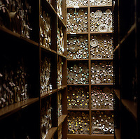 One of the many rooms of archives in Victoria Tower, with roll upon roll of statutes recorded on parchment. The shelves are metal and slate, a precaution against fire