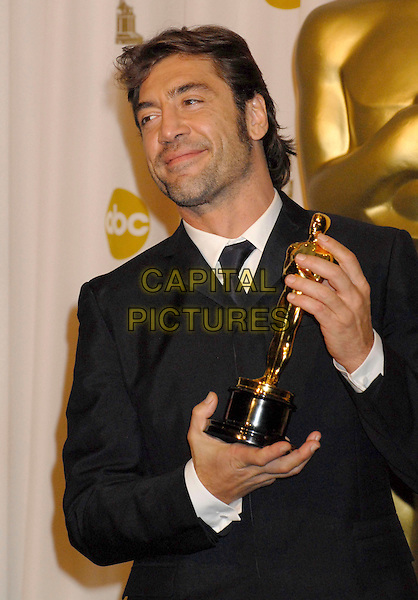 JAVIER BARDEM.The 80th Annual Academy Awards Press Room held at the Kodak Theatre, Hollywood, California, USA..February 24th, 2008.oscars award trophy winner half length black suit jacket stubble facial hair .CAP/ADM/BP.©Byron Purvis/AdMedia/Capital Pictures.