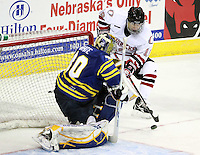 University of British Columbia goalie Jordan White sets up to block a shot by Nebraska Omaha's Ryan Walters. (Photo by Michelle Bishop) ..