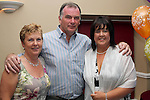 Olive Hanlon with her husband Shay and friend Martina Kelly at her suprise 50th birthday party in Harrys, Mell.  The three of them had completed a triathlon that day...Photo NEWSFILE/Jenny Matthews.(Photo credit should read Jenny Matthews/NEWSFILE)....This Picture has been sent you under the condtions enclosed by:.Newsfile Ltd..The Studio,.Millmount Abbey,.Drogheda,.Co Meath..Ireland..Tel: +353(0)41-9871240.Fax: +353(0)41-9871260.GSM: +353(0)86-2500958.email: pictures@newsfile.ie.www.newsfile.ie.FTP: 193.120.102.198.