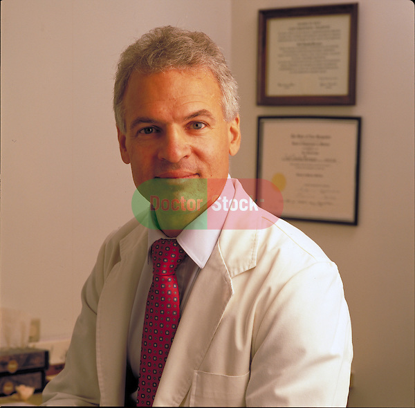 portrait of smiling doctor in his office