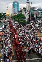 At least 50,000 people join a protest march led by Buddhist monks calling for the overthrow of the country's military junta.