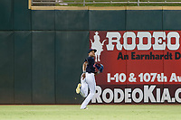 AZL Indians center fielder Quentin Holmes (70) pursues a fly ball against the AZL Rangers on August 26, 2017 at Goodyear Ball Park in Goodyear, Arizona. AZL Indians defeated the AZL Rangers 5-3. (Zachary Lucy/Four Seam Images)