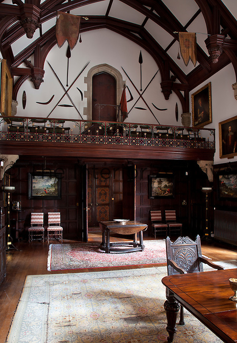 The minstrels gallery in the dining hall. The flags which hang from the hammerbeam ceiling are the guidons of the Thirteenth Light Dragoons of which General Henry Lygon was honorary colonel