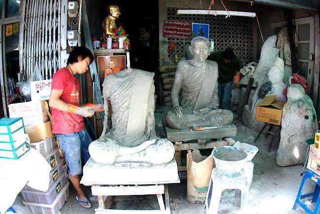 Preparing statue of Monk, Bangkok Amulet market