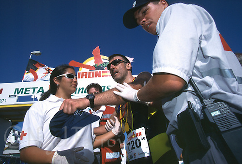 26 MAY 2001 - LANZAROTE, CANARY ISLANDS - Alessandri Francesco receives assistance from medics after finishing Ironman Lanzarote 2001. (PHOTO (C) NIGEL FARROW)