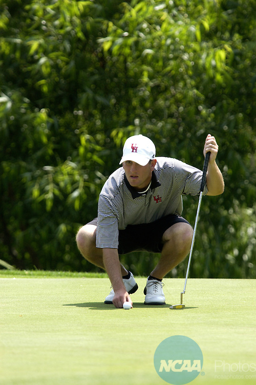 20 MAY 2005: University of Hawaii-Hilo golfer Nick Mason lines up his putt on the 13th green during the NCAA Division II Men's National Golf Championship at The Club at Savannah Harbor in Savannah, Ga.  He finished in second place. University of South Carolina Aiken finished first in the teams competition and USCA golfer Dane Burkhart won the individual title beating Mason by one stroke. Stephen Morton/NCAA Photos