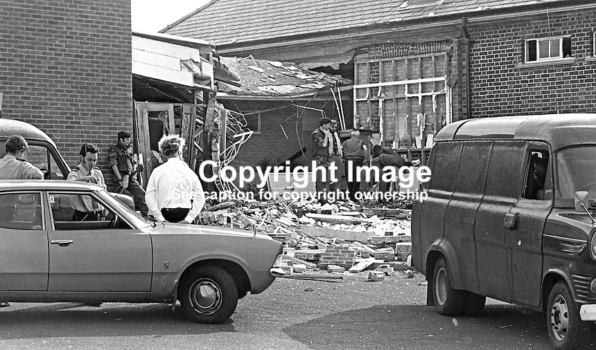 Police and soldiers at scene of explosion at Carrick Primary School, Lurgan, N Ireland, 7th July 1975. Andrew Johnston, an RUC detective from Armagh, died when a booby trap bomb placed in the desk of the headmaster, Alistair Black, exploded. It is believed the intended target was Mr Black who was a member of Ulster Vanguard and a member of the Northern Ireland Convention. 197507070533a.<br />