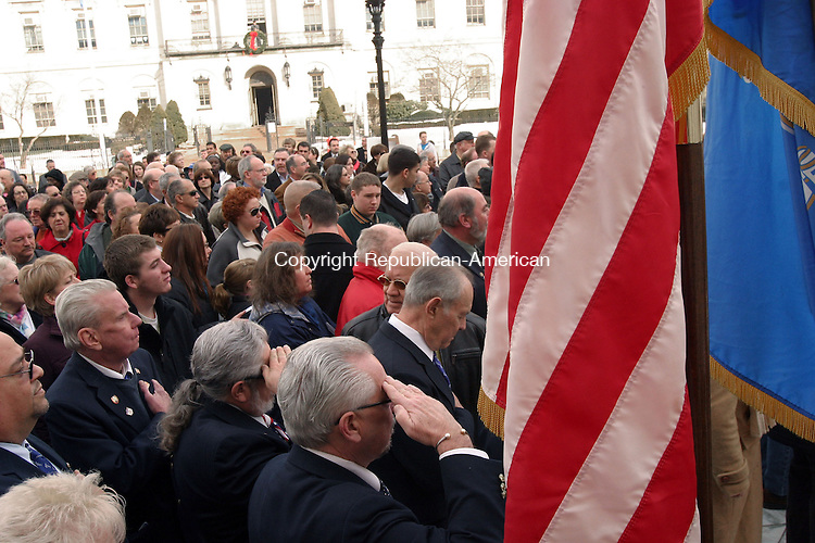 WATERBURY, CT-01 JANUARY, 2011-010111JS05-Guests pause for the Pledge of Allegiance during the official Rededication ceremony Saturday at City Hall in Waterbury. City Hall is now reopened following a 4-year $35.9 million renovation. <br /> Jim Shannon Republican-American