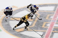 June 12, 2019: Boston Bruins center Sean Kuraly (52) races with the puck during game 7 of the NHL Stanley Cup Finals between the St Louis Blues and the Boston Bruins held at TD Garden, in Boston, Mass.  The Saint Louis Blues defeat the Boston Bruins 4-1 in game 7 to win the 2019 Stanley Cup Championship.  Eric Canha/CSM.
