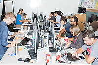 Participants work on projects at the Metric Geometry and Gerrymandering Group (MGGG) hackathon at the Data Lab in the Tisch Library at Tufts University in Medford, Massachusetts, USA, on Thurs., Aug. 10, 2017. The hackathon is part of the first in a series of Geometry of Redistricting workshops put on by the MGGG. Academics, Geographic Information Systems (GIS) professionals, and legal professionals worked together to build tools useful in analyzing voting district data around the country.