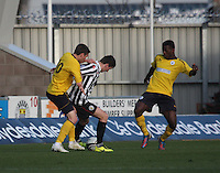 Kenny McLean shields the ball from Luke Leahy as he is tackled by  Bia-Bi Botti and in the St Mirren v Falkirk Clydesdale Bank Scottish Premier League Under 20 match played at St Mirren Park, Paisley on 30.4.13. .