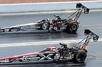Apr. 7, 2013; Las Vegas, NV, USA: NHRA top fuel dragster driver Spencer Massey (near) races alongside Bob Vandergriff Jr during the Summitracing.com Nationals at the Strip at Las Vegas Motor Speedway. Mandatory Credit: Mark J. Rebilas-