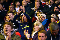 Sunday, 23 February 2014<br /> Pictured: Swansea City fans<br /> Re: Barclay's Premier League, Liverpool FC v Swansea City FC v at Anfield Stadium, Liverpool Merseyside, UK.
