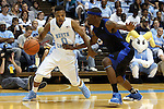 24 October 2014: North Carolina's Nate Britt (0) and Fayetteville State's Anthony Shelton (right). The University of North Carolina Tar Heels played the Fayetteville State University Broncos in an NCAA Division I Men's basketball exhibition game at the Dean E. Smith Center in Chapel Hill, North Carolina. UNC won the exhibition 111-58.