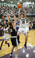 Fayetteville's Mathew Wayman (20) takes a shot in the lane Friday, Jan. 17, 2020, over Bentonville's Cooper Smith during the first half of play in Bulldog Arena in Fayetteville. Visit nwaonline.com/prepbball/ for a gallery from the games.<br /> (NWA Democrat-Gazette/Andy Shupe)