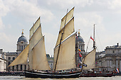 London, UK. 9 September 2014. Tall Ships pass the Royal Naval College. The Tall Ships that have taken part in the Royal Greenwich Tall Ships Festival 2014 leave Greenwich in a Parade of Sail down the River Thames.
