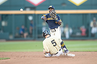 Michigan Wolverines second baseman Ako Thomas (4) turns a double play against the Vanderbilt Commodores during Game 3 of the NCAA College World Series Finals on June 26, 2019 at TD Ameritrade Park in Omaha, Nebraska. Vanderbilt defeated Michigan 8-2 to win the National Championship. (Andrew Woolley/Four Seam Images)