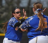 Crista San Antonio #6 of East Meadow, left, gets a high five from pitcher #48 Christina Loeffler after snagging a line drive to third base for the final out of the third inning in a Nassau County varsity softball game against Massapequa at Berner Middle School on Monday, Apr. 25, 2016. Massapequa won by a score of 6-4.
