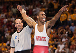 March 21 2009   Darrion Caldwell from North Carolina State (white and red uniform) celebrates his victory over Brent Metcalf of Iowa (not shown) in the 149 pound weight class in the championship round of the NCAA Division I  Wrestling Championships which were held March 19 through March 21, 2009 at the Scottrade Center in downtown St. Louis, Missouri. ..         *******EDITORIAL USE ONLY*******