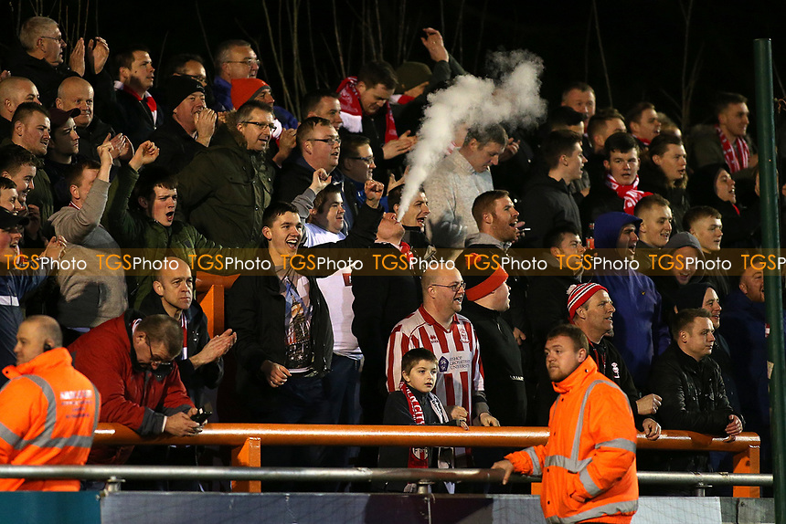 Lincoln City fans celebrate their first goal during Braintree Town vs Lincoln City, Vanarama National League Football at the IronmongeryDirect Stadium on 7th March 2017