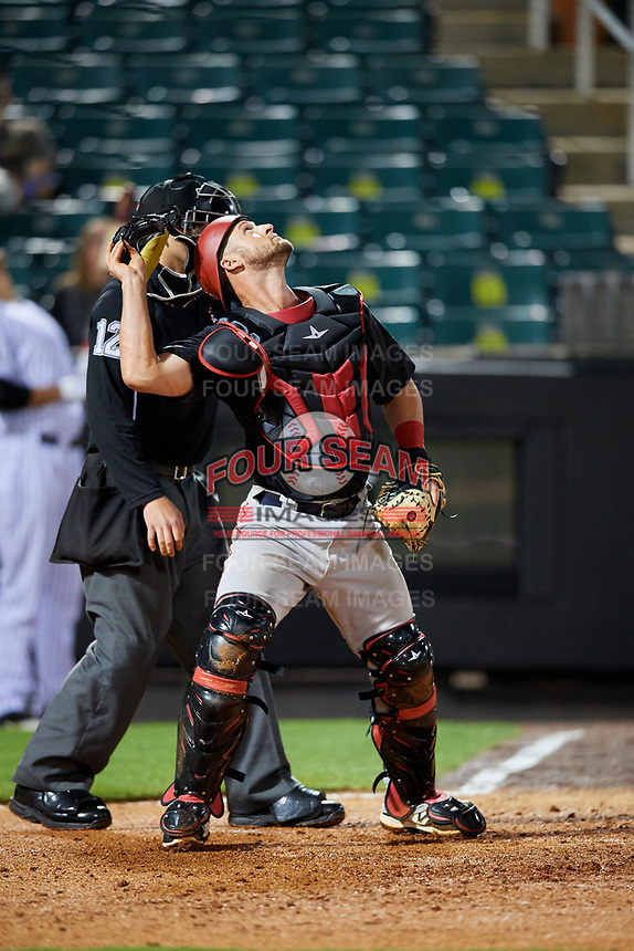 Chattanooga Lookouts catcher Dan Rohlfing (8) tracks a pop up in front of home plate umpire Brock Ballou during a game against the Jackson Generals on April 27, 2017 at The Ballpark at Jackson in Jackson, Tennessee.  Chattanooga defeated Jackson 5-4.  (Mike Janes/Four Seam Images)