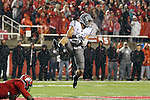 River Cracraft goes high to pull in a reception during the Washington State Cougars Pac-12 conference show down with the Utah Utes at Rice-Eccles Stadium in Salt Lake City, Utah, on September 27, 2014.  The Cougs came back from a 21-0 deficit to defeat the previously unbeaten Utes, 28-27.