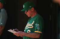 OAKLAND, CA - JULY 17:  Manager Bob Melvin #6 of the Oakland Athletics stands in the dugout during the game against the Seattle Mariners at the Oakland Coliseum on Wednesday, July 17, 2019 in Oakland, California. (Photo by Brad Mangin)