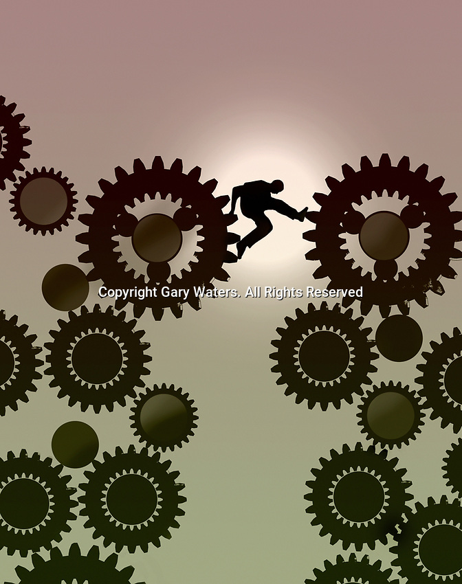 Man struggling to climb up cogs