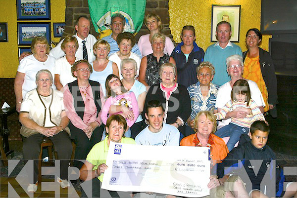 CHEQUE: Kit Ryan of Together Special Olympics accepting a cheque for 3,000 from Breda Murphy, committee member of the Kerins ORahillys Coffee Ladies. Also in picture are people who were involved in the fundraising. Front l-r: Kit Ryan, Fergal Quill and Breda Murphy. Back were Kathleen La Haye, Mary OBrien, Peggy Hegarty, Nellie Brosnan (president), Charly Wall, Betty OBrien, Kitty Enright, Chloe Wall, Lillian Inchley, Tom OShea, Helen OConnor, Joan Cunningham, Vincent Murphy, Nora Sweeney, Olivia Wall, Carmel Quill, Christine Curtin, Francis Quill and Noelle Murphy..