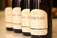 A range of wine bottles in a line, Cornas 2002, Saint Joseph, and Syrah. Domaine Eric et Joel Joël Durand, Ardeche, Ardèche, France, Europe