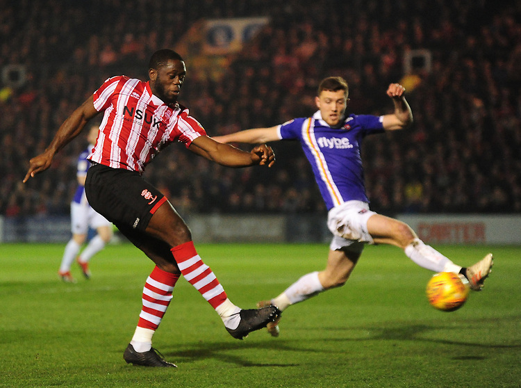 Lincoln City's John Akinde gets a shot on target under pressure from Exeter City's Dara O'Shea<br /> <br /> Photographer Andrew Vaughan/CameraSport<br /> <br /> The EFL Sky Bet League Two - Lincoln City v Exeter City - Tuesday 26th February 2019 - Sincil Bank - Lincoln<br /> <br /> World Copyright © 2019 CameraSport. All rights reserved. 43 Linden Ave. Countesthorpe. Leicester. England. LE8 5PG - Tel: +44 (0) 116 277 4147 - admin@camerasport.com - www.camerasport.com