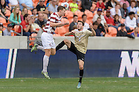 Houston, TX - Friday December 11, 2016: Tanner Beason (3) of the Stanford Cardinal heads the ball over Luis Argudo (2) of the Wake Forest Demon Deacons at the NCAA Men's Soccer Finals at BBVA Compass Stadium in Houston Texas.