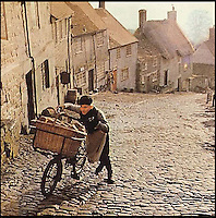BNPS.co.uk (01202 558833)<br /> Pic: Hovis<br /> <br /> Carl Barlow yesterday recreated his famous scene from Ridley Scotts 1973 Hovis advert - Voted Britain's favourite.<br /> <br /> The child actor who starred in the famous Hovis TV advert today marked its 40th anniversary by returning to the iconic cobbled hill to push his bike up it again.<br /> <br /> Carl Barlow was aged 13 when he won the starring role as a bakery delivery boy for the TV commercial that has been voted as the nation's favourite.<br /> <br /> In the ad, the teenager was filmed struggling to push a bike laden with freshly baked bread up the steep hill to 'Old Ma Peggotty's house', the last customer on his round.<br /> <br /> The advert, directed by Ridley Scott, was meant to depict a northern industrial town but was actually shot on Gold Hill in Shafesbury, Dorset.